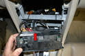 Tilt the unit forward so you can have access to the wiring on the rear (red arrow).