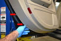 Use a trim removal tool or just your hands and starting at the lower corner separate the door panel from the door by pulling it out and away (red arrows).