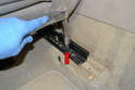 Front Seats: Use a 10mm 12 point and remove two bolts (red arrow, one on each side) holding the rail to the frame.
