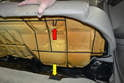 Rear Seat Bench: This photo illustrates the metal clip on the seat (red arrow) that sits in a plastic cup in the chassis (yellow arrow).