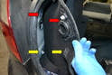 Use a trim removal tool or your hands and work the trim piece away from the chassis.