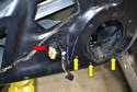Remove the rubber grommet and push the wires into the door (red arrow).