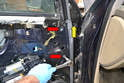 Remove the two T45 bolts (red arrows) and the single T30 bolt from the forward section of the door.