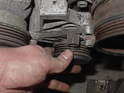 These next two photos illustrate the movement of the air conditioning belt tensioner pulley.