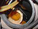 Looking down into the tank with the fuel pump removed, you can see the well into which the fuel pump is installed, as well as the float-and-arm assembly that rises and falls with the fuel level inside the tank.