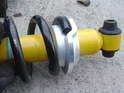 Take note of how the stock spring rests upon the lower spring perch that comes with the new Bilstein shock.