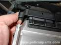 The clip should have more than an inch of travel, and the connector should automatically release from the ECU.