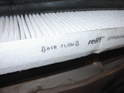 Note the air flow direction indicator printed on the side of the new air filter.