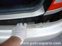 Once the bumper is free, pull it straight away from the back of the car.