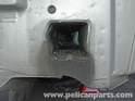 This is one of the deep recesses that receive the impact rams of the rear bumper.