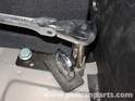 Open up your trunk, lift up the carpeted panel that forms the floor of the trunk, and locate the two fasteners on each side.