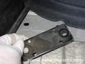 This black plate will be loose once you remove the trunk bolts, but there is no need to remove it.