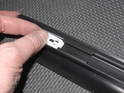 This sequence shows how the plastic clip fits into the back of the trim piece .