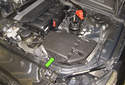 The air filter element is located inside of the intake air housing (green arrow) in the left side front of the engine compartment on normally aspirated 6- and 8-cylinder E60 models.