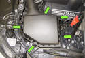 8-cylinder engine: Working around the perimeter of the intake air housing, unclip the housing lid retainers (green arrows).