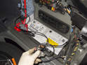 Replacing battery: Move both battery cables toward the spare tire and away from the battery.