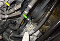 Locate the AC drive belt tensioner (green arrow).