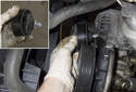 Accessory belt idler pulley: Unscrew and remove the idler pulley from the engine.