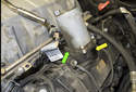 This photo shows oil residue (green arrow) and a fresh oil leak (yellow arrow) at the front of the Valvetronic motor.