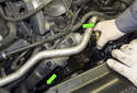Remove the radiator hoses from the thermostat and coolant pump.