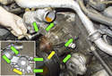 Remove the four 10mm water pump mounting fasteners (green arrows).