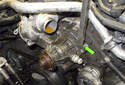 Using a large flathead screwdriver or pry bar, gently lever the coolant pump away from the timing cover.