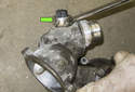 With the coolant pump on the bench, remove the coolant temperature sensor using a 22mm wrench.