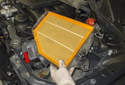 Once the lid has been removed, lift the air filter housing out of the engine compartment.