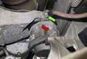 Working from below the engine, remove the 13mm ground strap nut (green arrow).