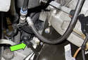 NG6 6-cylinder engines: Working at the engine oil dipstick tube, remove the crankcase valve drain hose (green arrow).