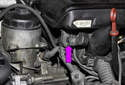 M54 6-cylinder engine: Working at front of intake manifold, pull evaporative emission purge solenoid off mounting bracket.
