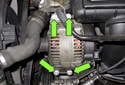 All NG6 engines: Remove the four E12 alternator fasteners (green arrows).