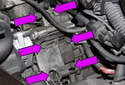 M54 6-cylinder engine: Remove the six 13mm oil filter housing fasteners (purple arrows).