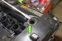 6-cylinder engine: Once new sensor is installed remove eccentric shaft sensor seal (green arrow) from valve cover.