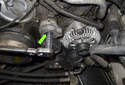 Next, remove the drive belt tensioner.