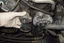 Remove the belt tensioner from the engine.