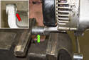 If you're reinstalling an old or used alternator, you may have to move the bushing (red arrow) out of the mounting ear for proper fit to the alternator bracket.