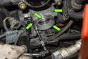 Remove the four 10mm throttle-housing fasteners (green arrows).