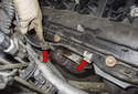 Pull the oxygen sensor wires and mounting clips (red arrows) off the valve cover and lay aside.