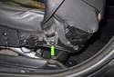 B-pillar trim: Next, remove the T50 Torx seat belt fastener (green arrow).