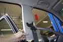 B-pillar trim: Slide the upper B-pillar trim panel down and remove it from the body.