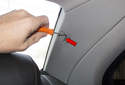 C-pillar trim: Using a plastic prying tool, gently lever out the fastener trim cover (red arrow).
