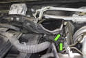 Working at the right and left side of the intake duct, remove the two 10mm fasteners (green arrows).