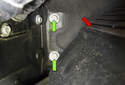 Move to the right side and remove the two 10mm fasteners (green arrows).