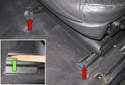 Front Seat: Using a plastic prying tool, release the seat rail trim cover (red arrows) retaining clips (green arrow) and remove them by sliding them forward.