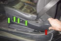 Switch replacing: Working at the side of the seat, pull the trim panel off starting at the rear (red arrow).
