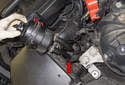 Lift the power steering reservoir up and slide the mounting bracket (red arrow) down.