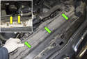 Then pull the coolant reservoir / radiator vent hose out of the plastic mounts (green arrows).