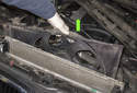 Then pull the cooling fan up and remove it from the engine compartment.