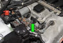 Unlock the ignition coil electrical connector by pulling the tab up 90° (green arrow).
